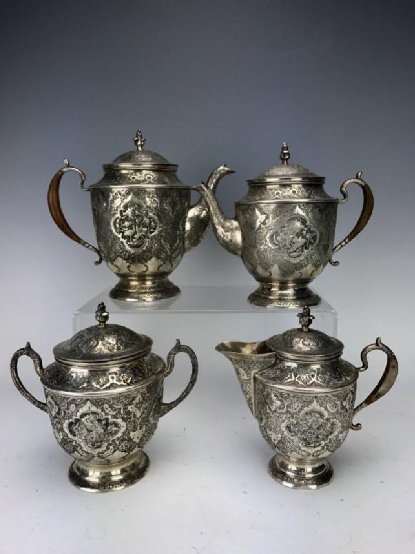 A FINE PERSIAN SILVER 4 PIECE TEA SET