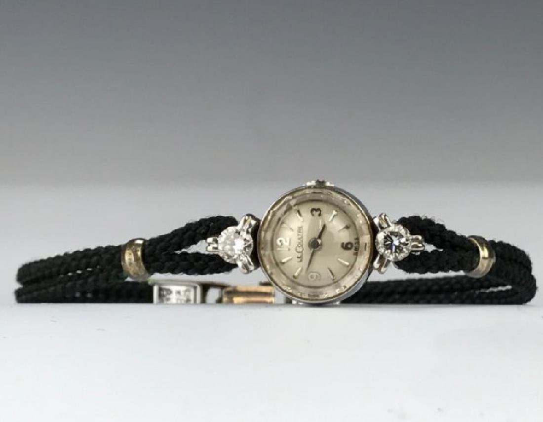 A 14KT AND DIAMOND MOUNTED JAEGER LE COULTRE WATCH