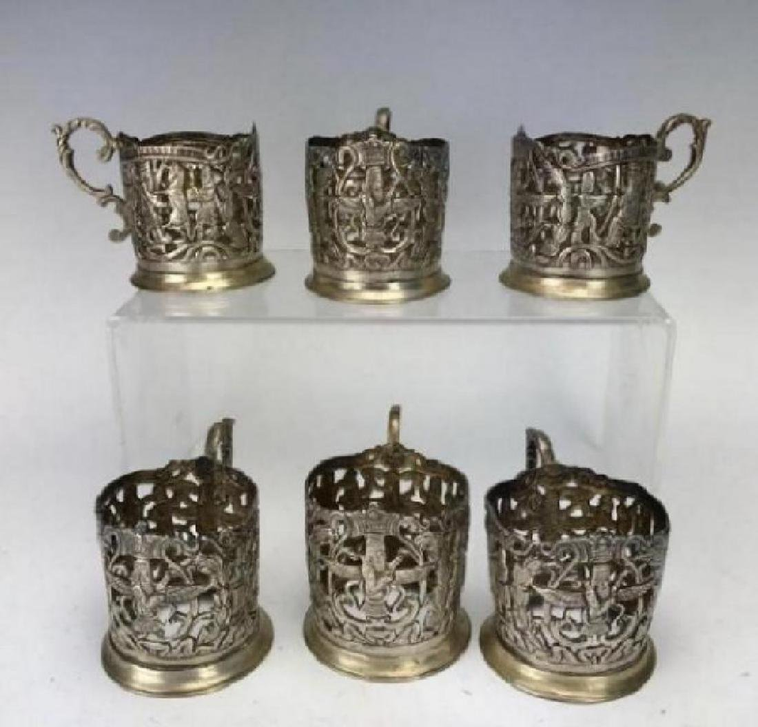 SET OF SIX LARGE SHIRAZ SILVER TEA CUP HOLDERS