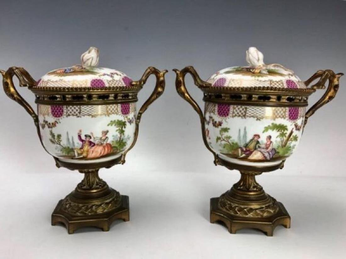 A PAIR OF ORMOLU MOUNTED MEISSEN VASES AND COVERS
