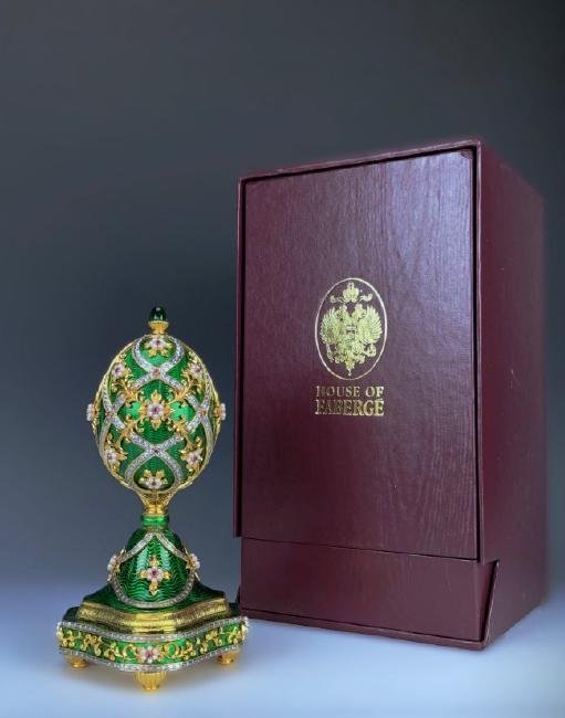 A HOUSE OF FABERGE MUSICAL STERLING GEMSET EGG