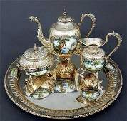 A VERY FINE CONTINENTAL SILVER AND ENAMEL TEA SET