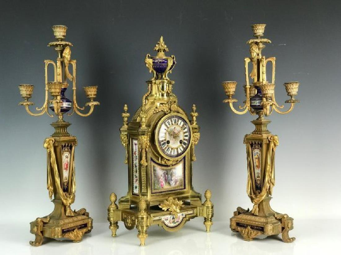 AN IMPOSING 19TH C. JEWELED SEVRES AND ORMOLU CLOCK SET