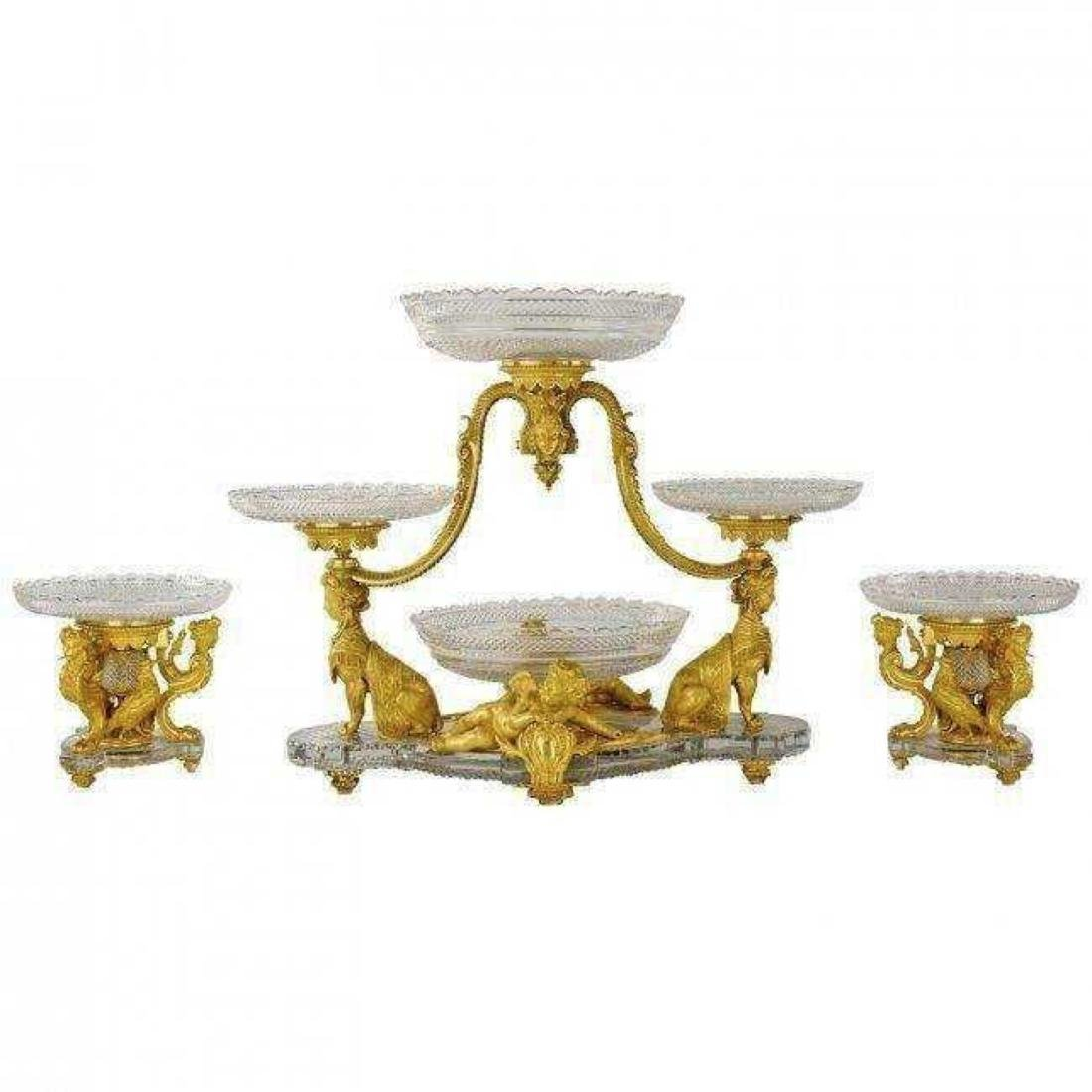 AN IMPOSING ORMOLU AND BACCARAT CRYSTAL GARNITURE