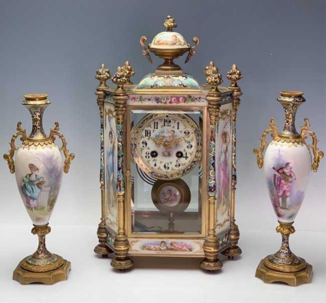 AN IMPOSING CHAMPLEVE ENAMEL &SEVRES CLOCK GARNITURE