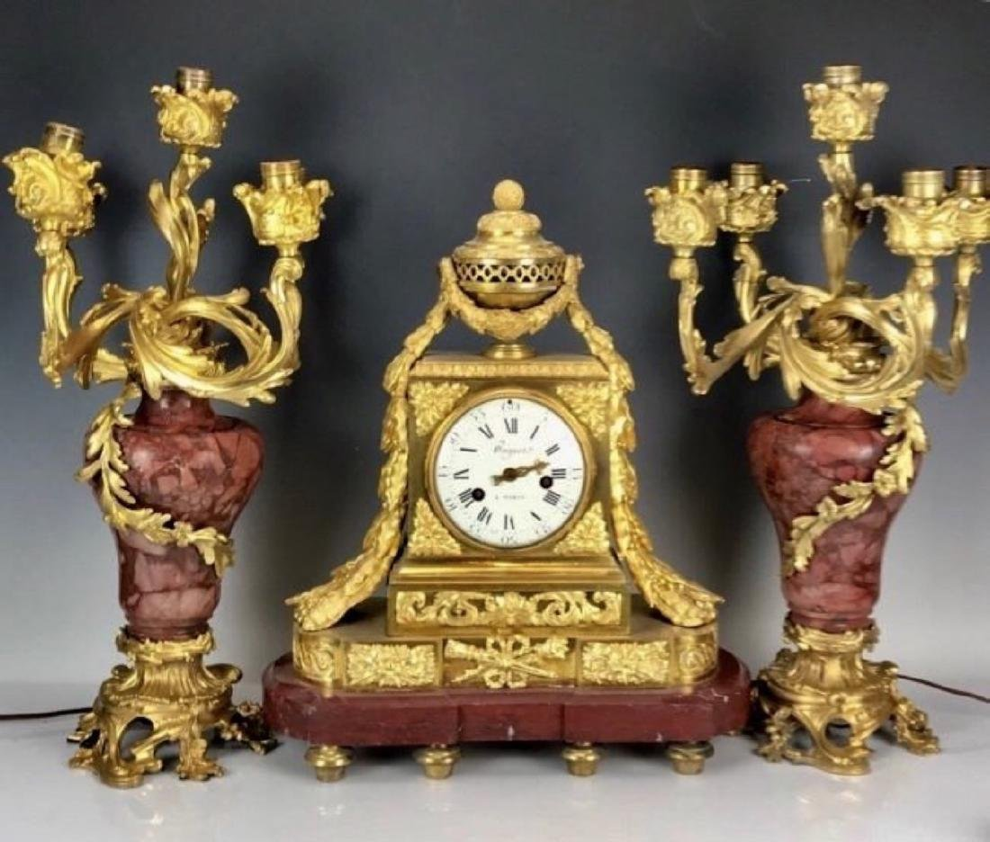 A FINE DORE BRONZE AND ROUGES MARBLE CLOCK SET