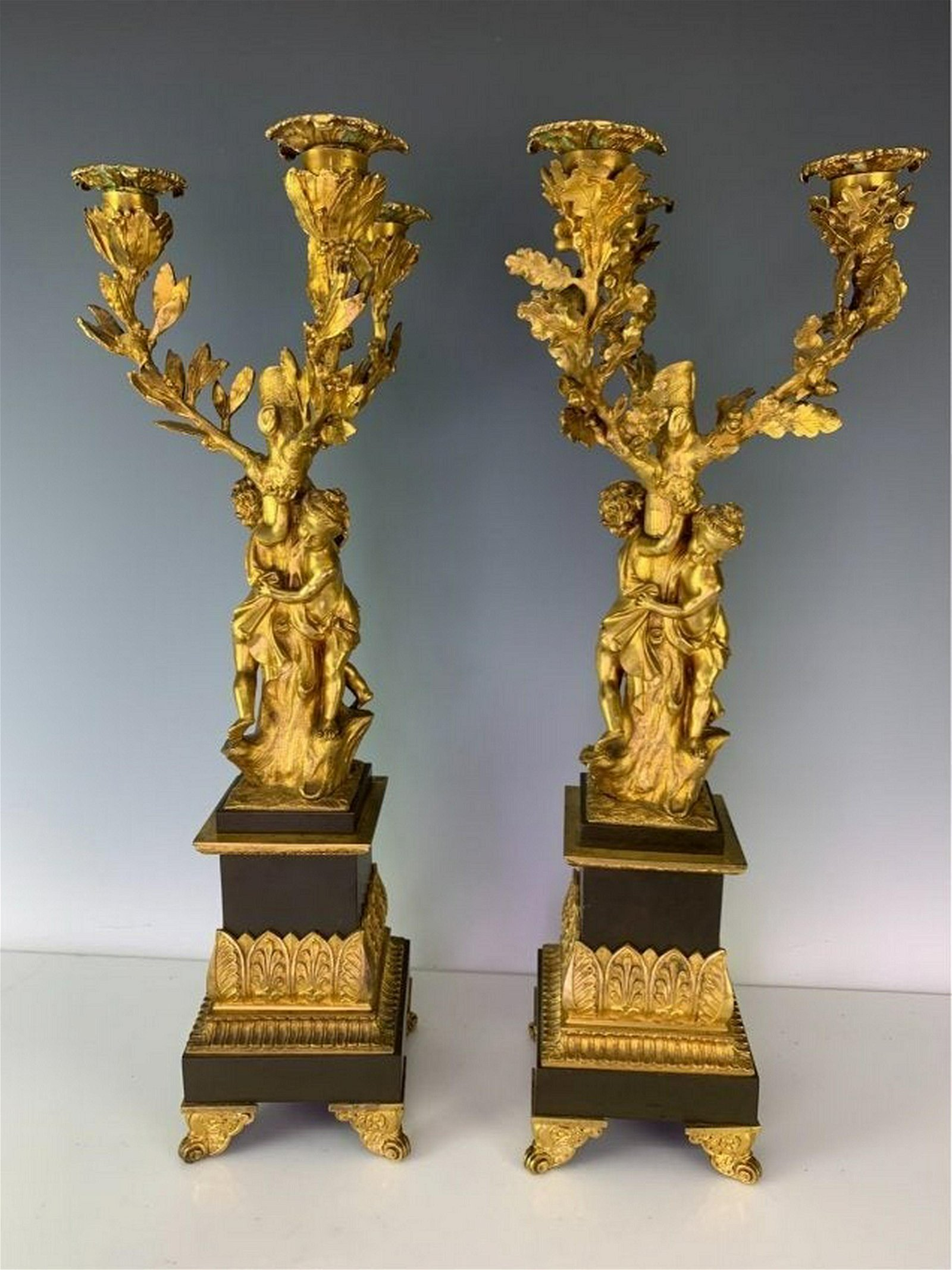 PAIR EMPIRE STYLE DORE AND PATINATED BRONZE CANDELABRA