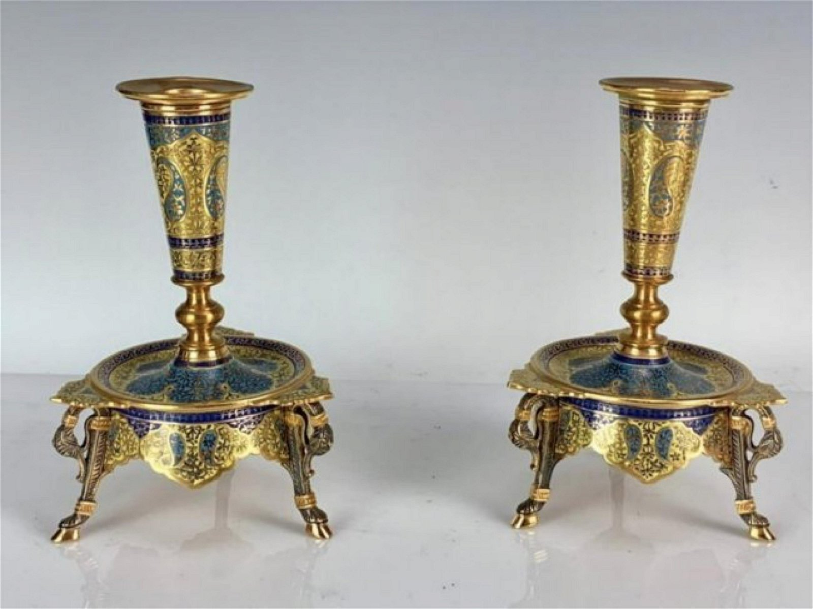 A PAIR OF FRENCH CHAMPLEVE ENAMEL CANDEL HOLDERS