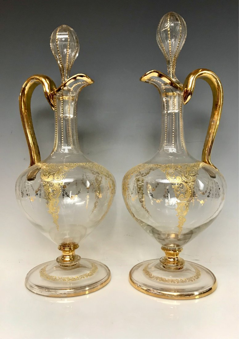 A PAIR OF GILT SAINT LOUIS DECANTERS