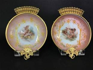 A PAIR OF ENAMELED BACCARAT OPALINE WALL PLAQUES