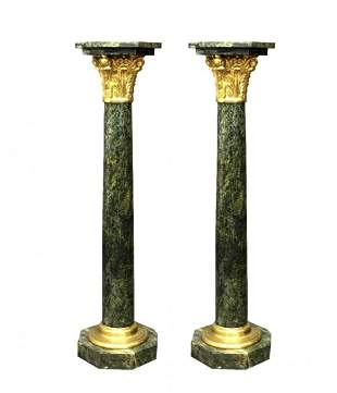 A PAIR OF FRENCH ORMOLU MOUNTED MARBLE PEDESTALS
