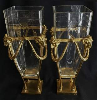 A PAIR OF ORMOLU MOUNTED BACCARAT CRYSTAL VASES