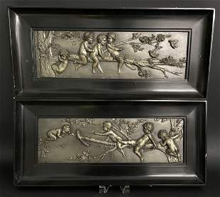 A PAIR OF SILVER PLATED PLAQUES