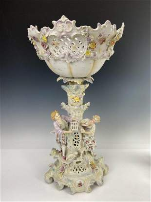 A LARGE BISQUE PORCELAIN CENTERPIECE