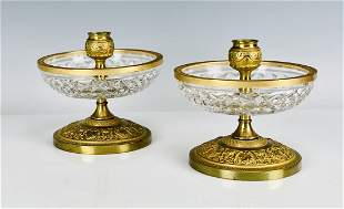 A PAIR OF ORMOLU MOUNTED BACCARAT GLASS CANDEL HOLDERS