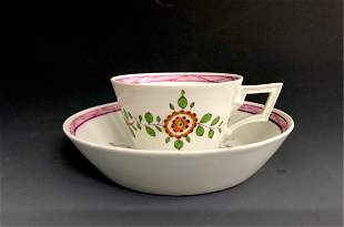 A  MEISSEN MARCOLINI CUP AND SAUCER