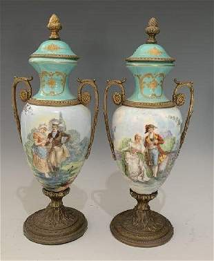 A PAIR OF FRENCH PORCELAIN AND BRONZE VASES
