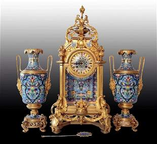 A MAGNIFICENT FRENCH CHAMPLEVE ENAMEL CLOCK SET
