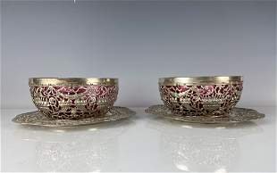 A PAIR OF CONTINENTAL SILVER AND RUBY GLASS FINGER BOWL