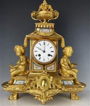 A VERY FINE ORMOLU MOUNTED SEVRES PORCELAIN CLOCK