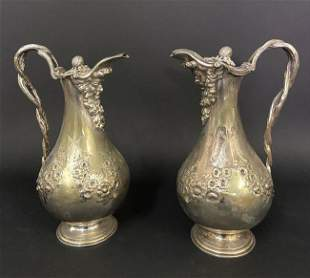 A PAIR OF 19TH C. SILVER PLATED CLARET JUGS