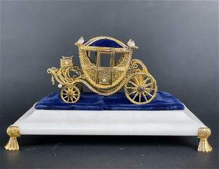 AN IMPERIAL FABERGE PARCEL GILT STERLING SLEIGH