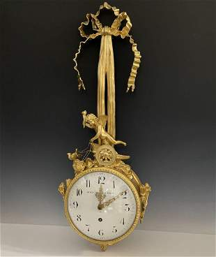 A LARGE FRENCH DORE BRONZE FIGURAL CLOCK