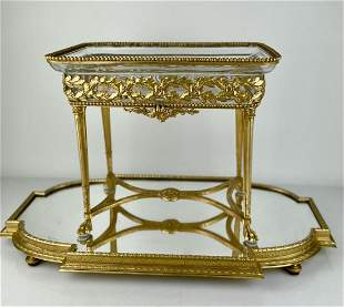 A LARGE EMPIRE STYLE DORE BRONZE AND BACCARAT CENTERPIE