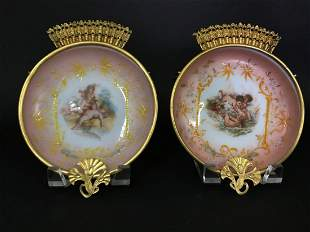 A PAIR OF ORMOLU MOUNTED OPALINE WALL PLAQUES