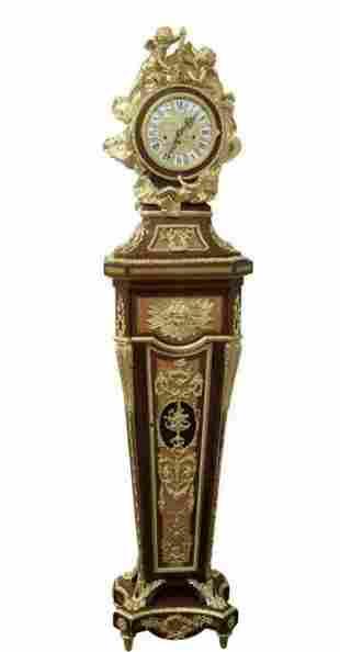 A LOUIS XVI STYLE ORMOLU MOUNTED CLOCK