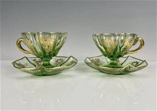 A PAIR OF GILT MOSER CUP AND SAUCERS