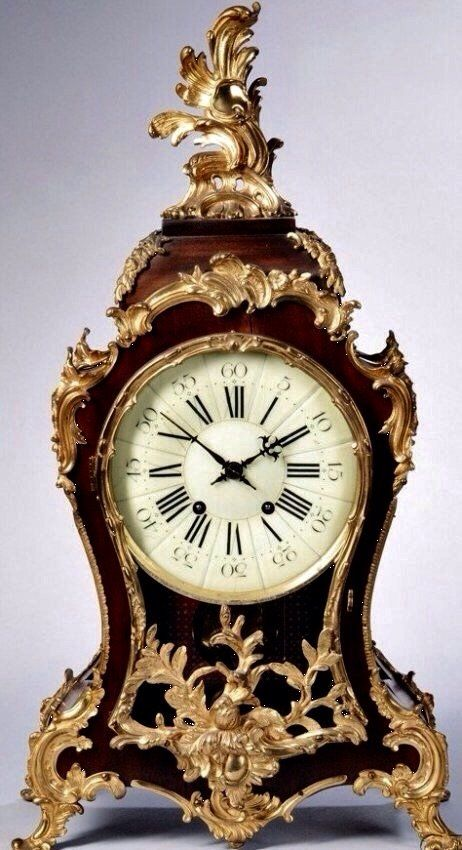 A LARGE LOUIS XV STYLE GILT BRONZE MOUNTED CLOCK