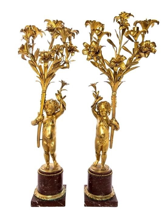 A  PAIR OF DORE BRONZE AND ROUGES MARBLE CANDELABRA
