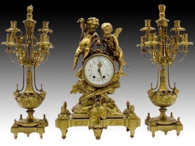 A 19TH CENTURY DORE BRONZE FIGURAL CLOCK GARNITURE