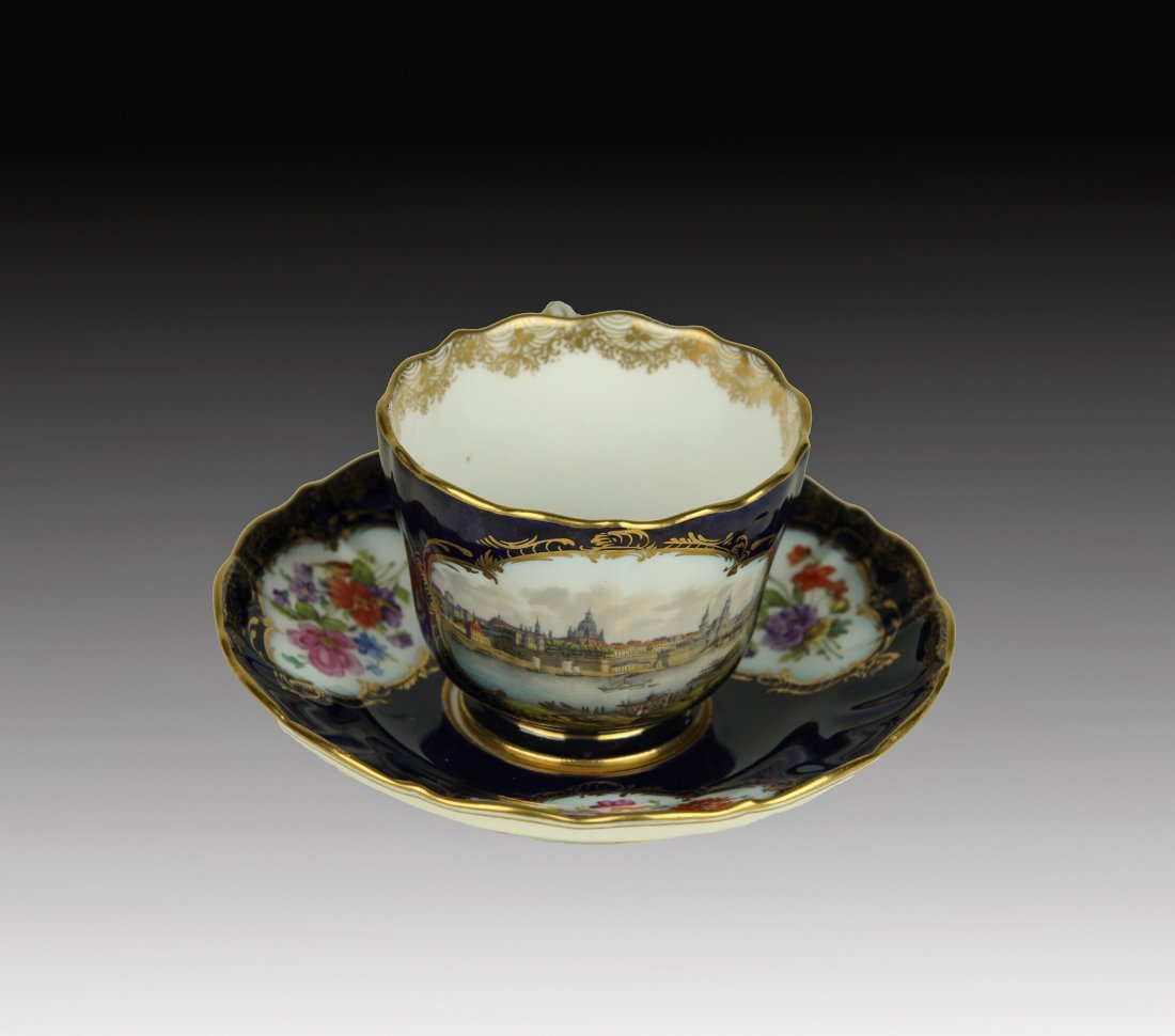 19TH CENTURY TOPOGRAPHICAL MEISSEN CUP AND SAUCER