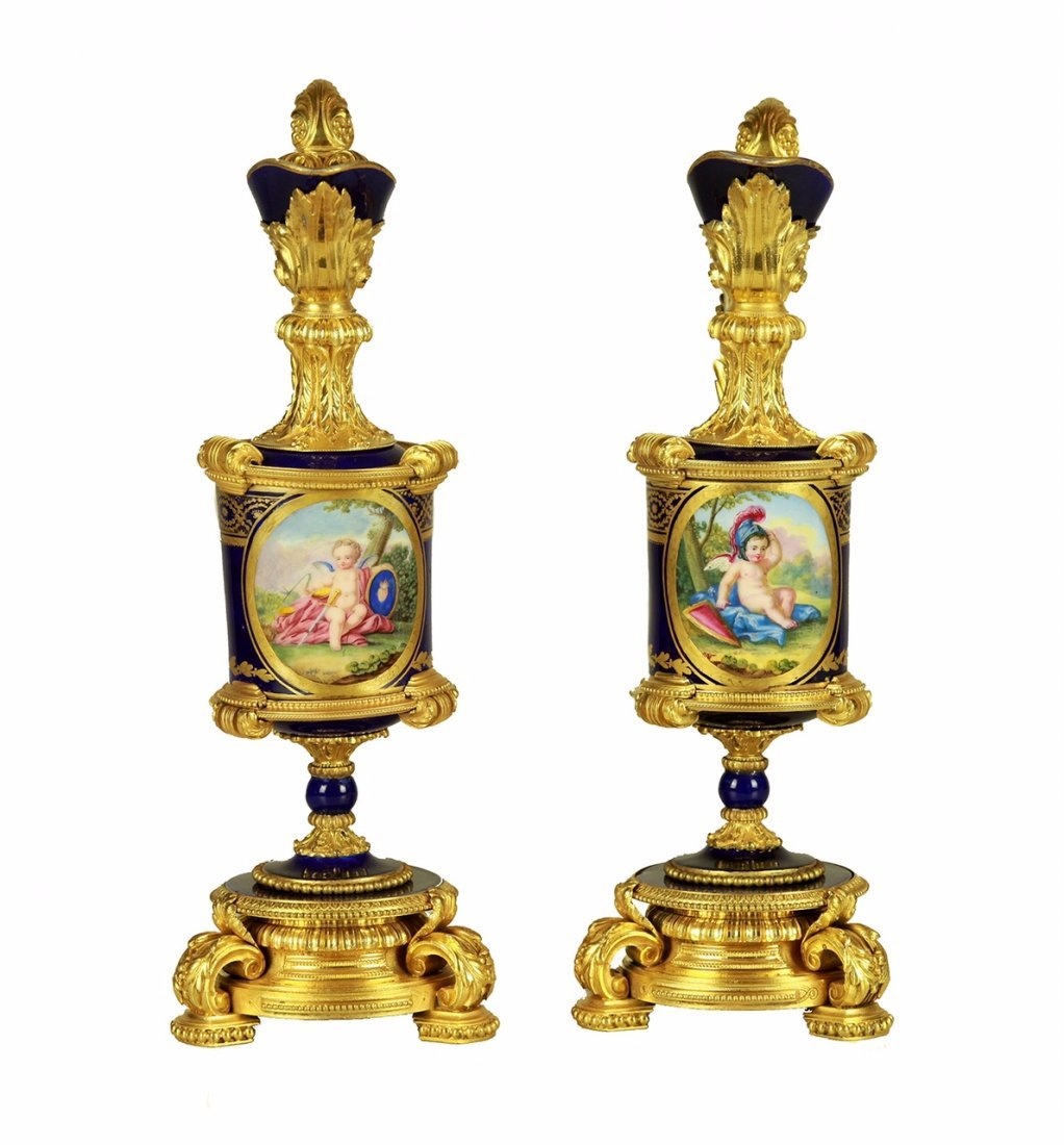 A SUPERB PAIR OF ORMOLU MOUNTED SEVRES EWERS