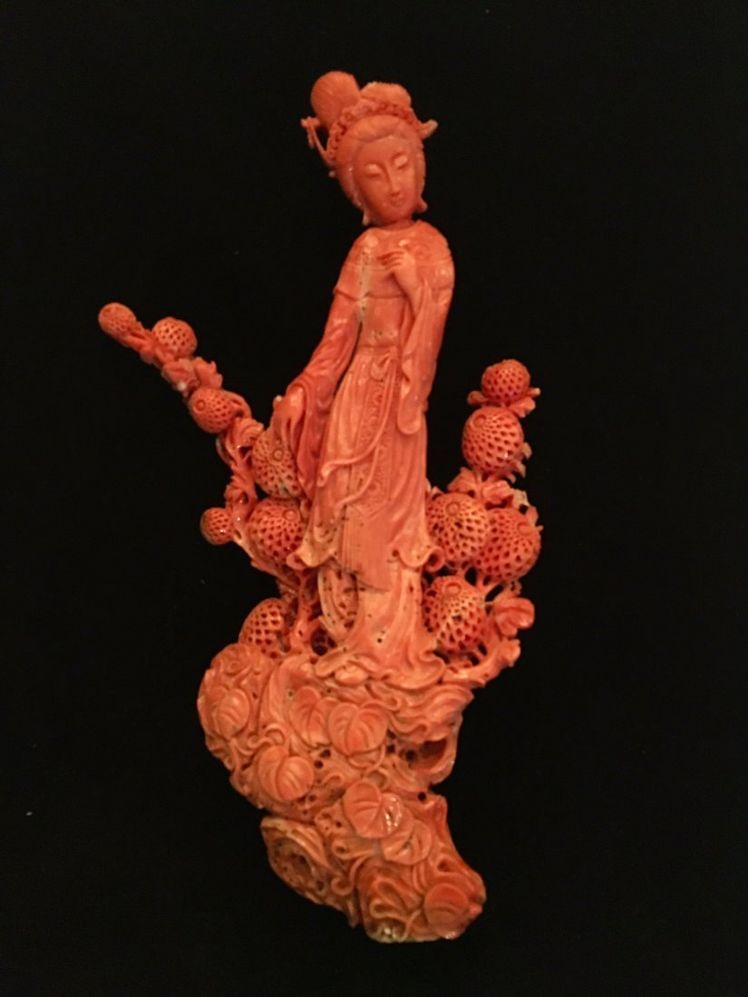 A MAGNIFICENT CHINESE CORAL CARVING OF A GUANYIN