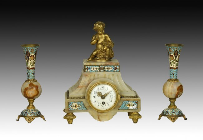 19TH CENTURY FRENCH CHAMPLEVE ENAMEL CLOCK SET