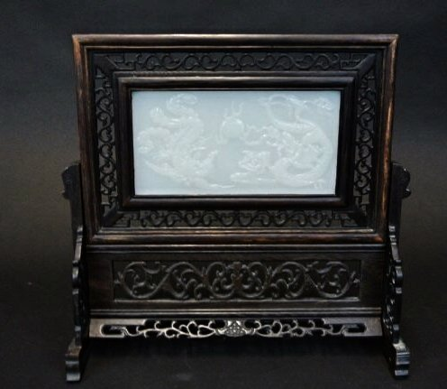 CHINESE WHITE JADE AND CARVED WOOD TABLE SCREEN.