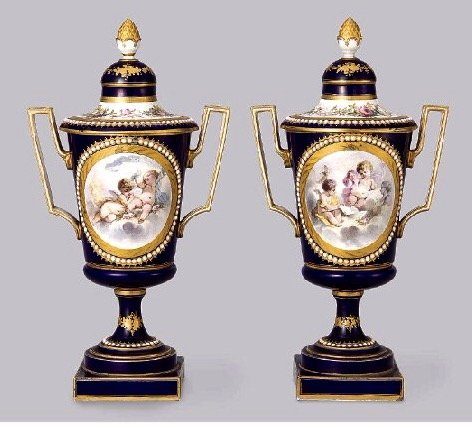 A PAIR OF 19TH CENTURY JEWELLED SEVRES VASES