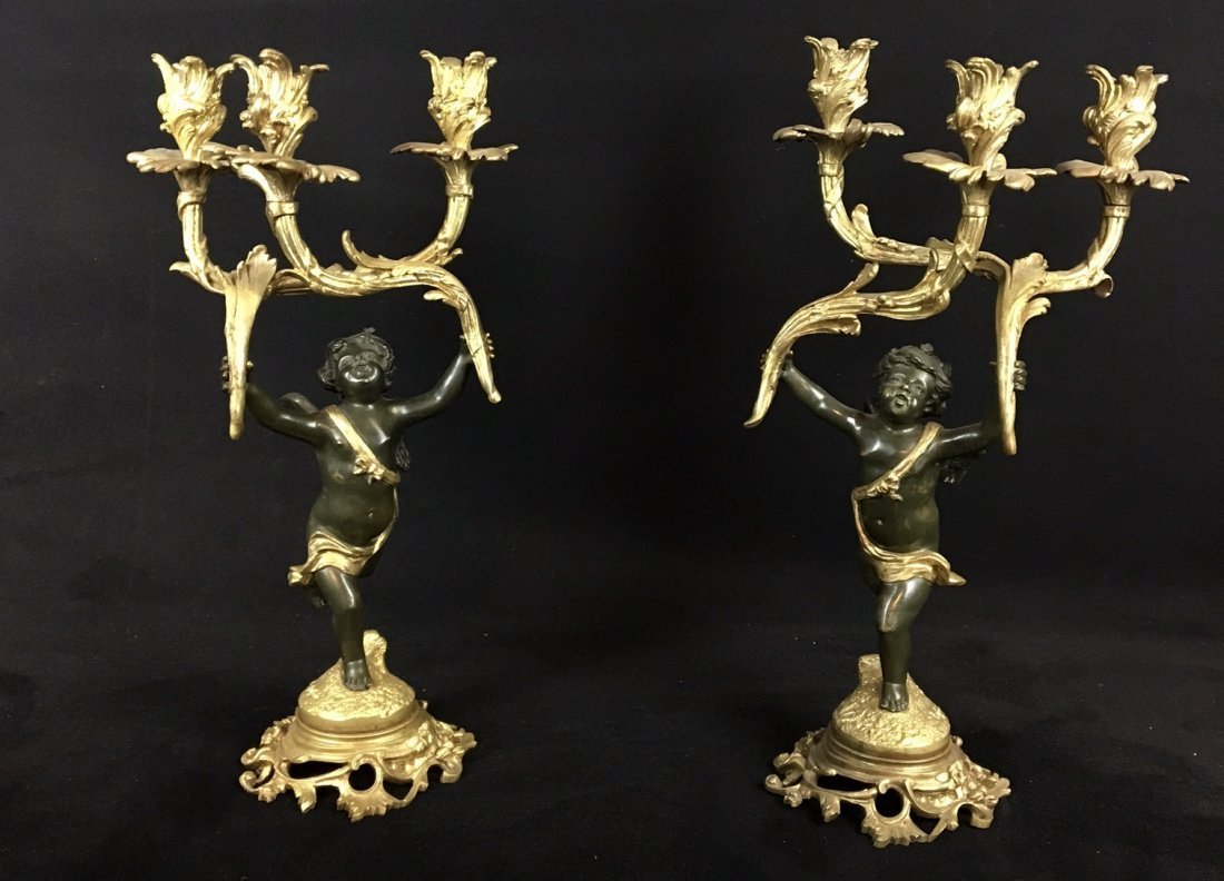 A PAIR OF 19TH CENTURY BRONZE CANDELABRAS