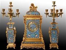 19TH CENTURY CHAMPLEVE ENAMEL CLOCK SET