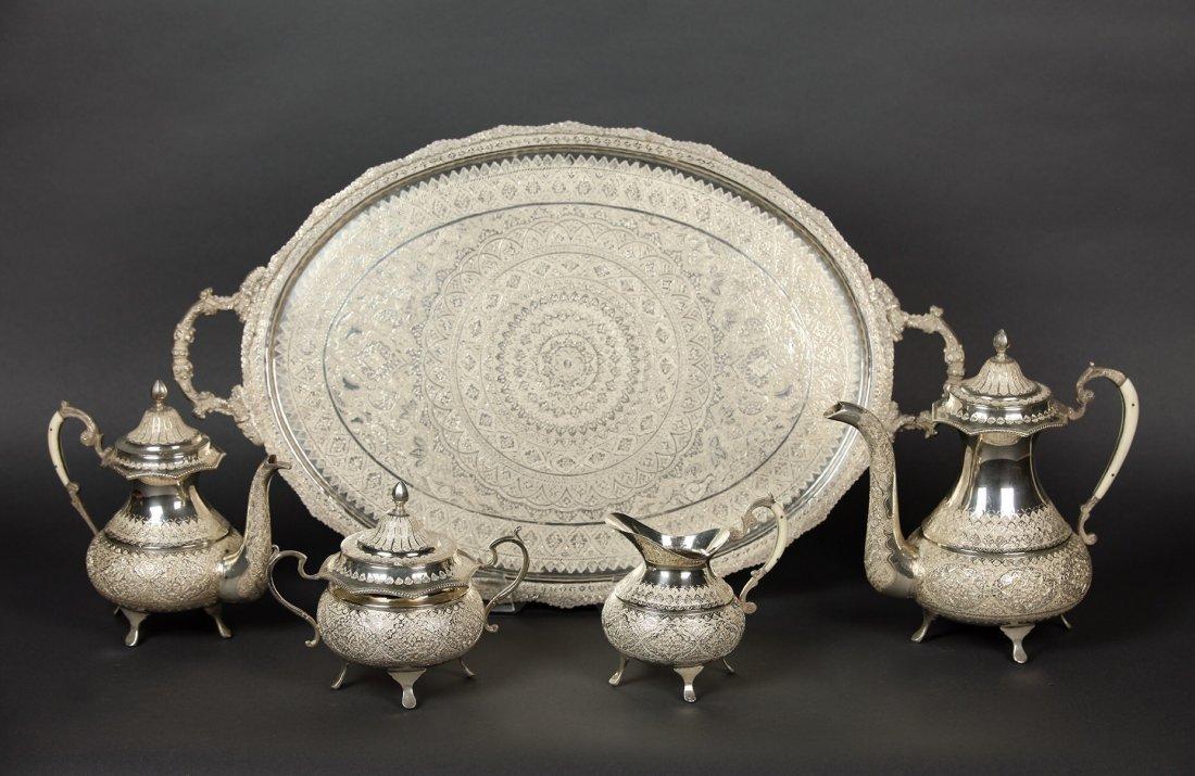 A LARGE IRANIAN SILVER TEA SET AND A TRAY