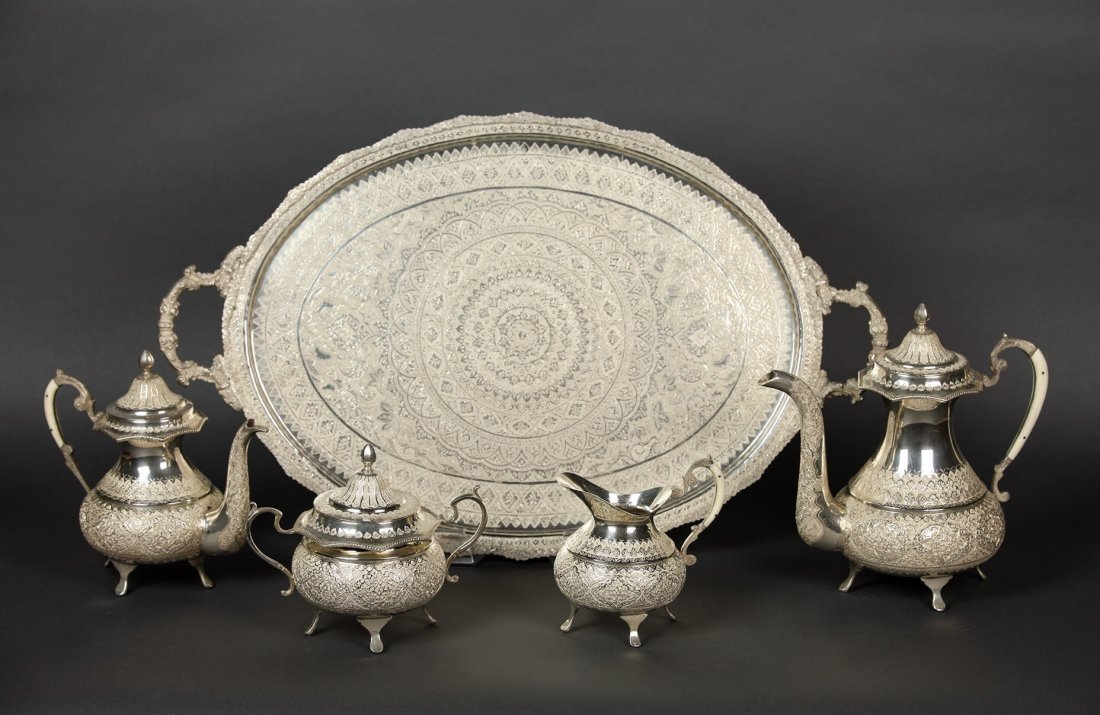 A LARGE IRANIAN SILVER TEA SET AND A TRAY