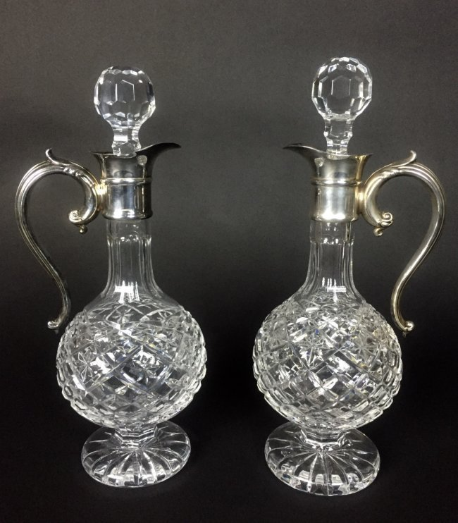 A PAIR OF SIGNED WATERFORD GLASS AND SILVER WINE CARAFE