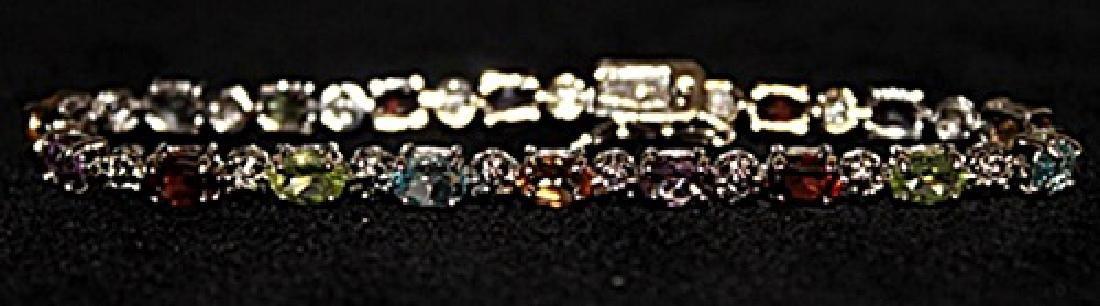 Lady's Fancy Diamond, Topaz, Citrine, Amedyst & Garnet