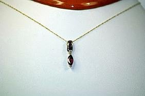 Beautiful 14kt Yellow Gold Ruby pendant & necklace.