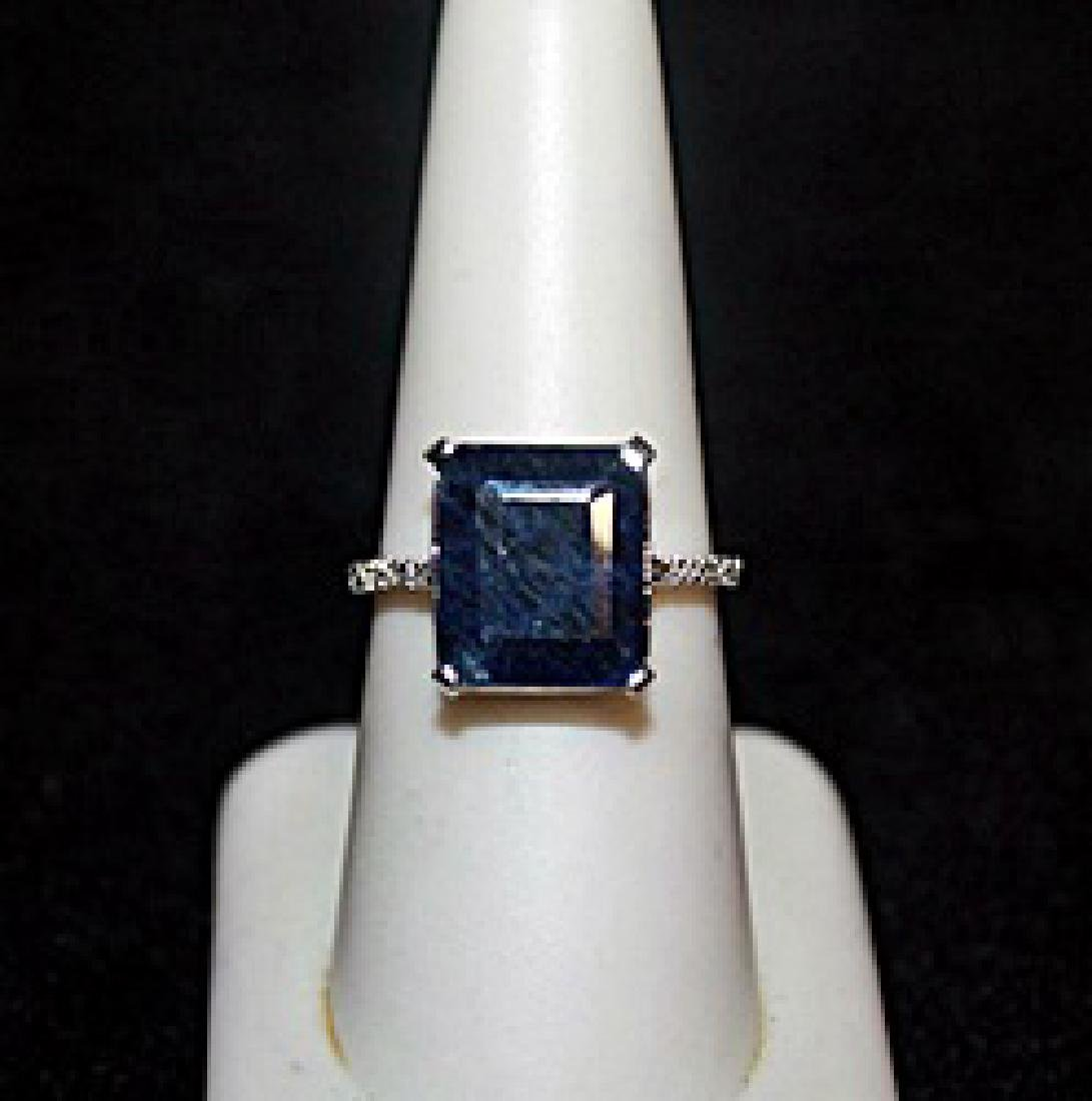Lady's Fancy Emerald Cut Sapphire with Diamond Chips