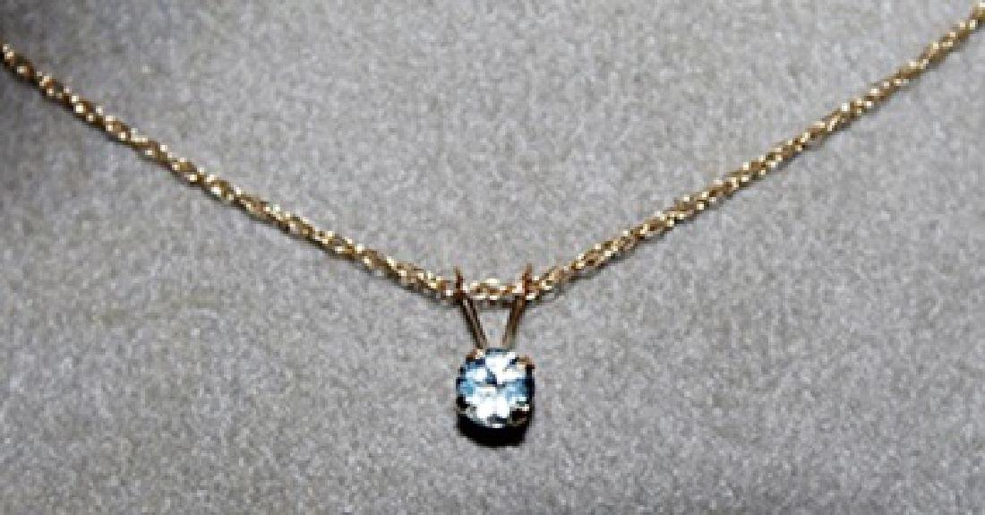 Lady's Fancy White Sapphire and 10kts Gold Necklace.