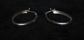 Lady's Fancy Sterling Silver Hoop Earrings.